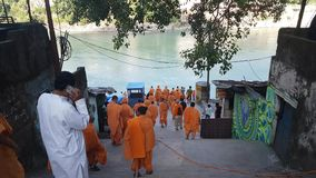 Monks with Saffron Robes on Ganga Ghat. Monks with Saffron Robes on Ganges Ghat stock video