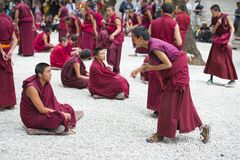 Buddhist monks` debating practice ,one is asking , Sera monastery , Lhasa , Tibet stock photography