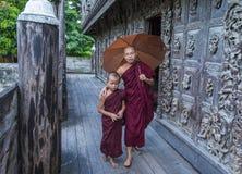 Monks at Shwenandaw Monastery in Mandalay , Myanmar Royalty Free Stock Photos