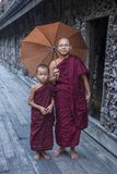 Monks at Shwenandaw Monastery in Mandalay , Myanmar. MANDALAY , MYANMAR - SEP 02 : Monks at Shwenandaw Monastery in Mandalay, Myanmar on September 02 2017 Stock Photography