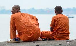Monks sitting on the bank of Ganges river in Varanasi, India.  Royalty Free Stock Photography