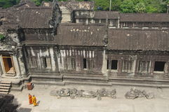 Monks strolling at Angkor Wat royalty free stock photo