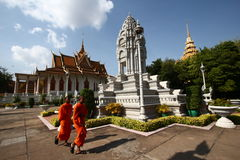 Monks and Stupas in the Royal Palace of Cambodia. Monks and stupas on the Royal Palace complex of Phnom Penh, Cambodia Royalty Free Stock Images