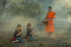 Monks teach and bless her with kindness. Monks teach and bless her with kindness Stock Photos