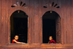 Monks in teak monastery near lake Inle. royalty free stock photography