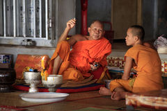 Monks in temple Stock Images