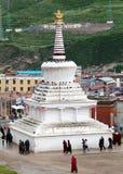 Monks and Tibetan people walking around stupa Royalty Free Stock Image