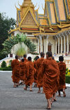 Monks tour the Royal Palace in Phnom Penh, Cambodia Royalty Free Stock Images