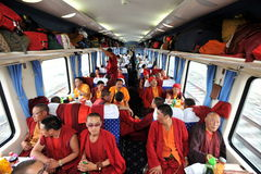 Monks-tourists Royalty Free Stock Photos