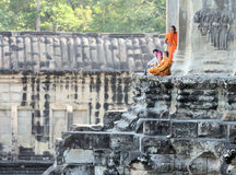 Monks and tourists Stock Images
