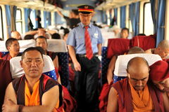 Monks-tourists in train Royalty Free Stock Photography