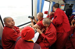 Monks in train. Tibetan monks going by train to Lhasa Royalty Free Stock Photo