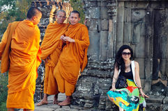 Monks and traveler in Cambodia Royalty Free Stock Photo