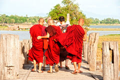 Monks and visitors walking on the U-bein ฺBridge,Myanmar. Royalty Free Stock Image