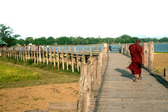 Monks and visitors walking on the U-bein ฺBridge,Myanmar. Stock Photos
