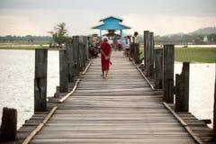 Monks and visitors walking on the U-bein ฺBridge,Myanmar. Stock Images