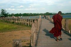 Monks and visitors walking on the U-bein ฺBridge,Myanmar. Stock Photos