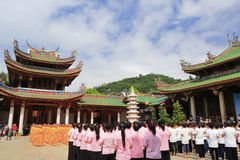Monks and volunteers gathering in nanputuo temple Stock Photo