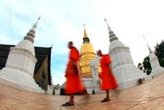 Monks walk pass Pagoda. Monks walk through the Pagoda Stock Photo