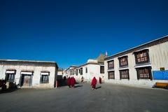 Monks walk in Tashilhunpo monastery. SHIGATSE, TIBET, CHINA-SEPTEMBER 16, 2015: Monks walk in Tashilhunpo monastery in Shigatse, Tibet Royalty Free Stock Image