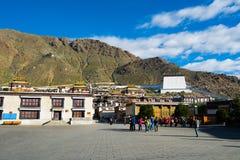 Monks walk in Tashilhunpo monastery. SHIGATSE, TIBET, CHINA-SEPTEMBER 16, 2015: Monks walk in Tashilhunpo monastery in Shigatse, Tibet Stock Images