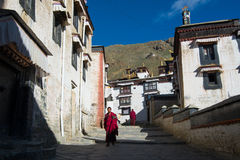 Monks walk in Tashilhunpo monastery. SHIGATSE, TIBET, CHINA-SEPTEMBER 16, 2015: Monks walk in Tashilhunpo monastery in Shigatse, Tibet Royalty Free Stock Photos