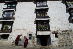 Monks walk in Tashilhunpo monastery. SHIGATSE, TIBET, CHINA-SEPTEMBER 16, 2015: Monks are in Tashilhunpo monastery in Shigatse, Tibet Royalty Free Stock Photos