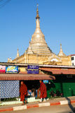 Monks walking in front of the stupa at the village of Kalaw on M Stock Image
