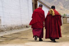 Monks walking in monastery royalty free stock photos