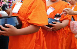 Monks walking for receive food from buddhist people in the morning Stock Image