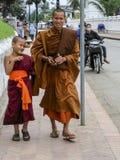 Monks walking in the street,luangprabang,laos. Monks walking in the street is taken in luangprabang,laos Stock Photos