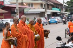 Monks walking on the street to collect alms and offerings in the morning for alms-gathering royalty free stock images