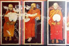 Monks on the wall Royalty Free Stock Photography