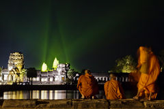 Monks watch the evening light show at Angkor ruins Royalty Free Stock Image