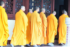 Monks wear yellow cassock Royalty Free Stock Images