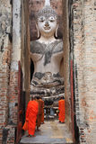 Monks worship Buddha statue at Wat Sri Chum in Sukhothai Stock Image