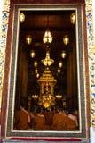 Monks worshipping at Wat pathumwanaram. Royalty Free Stock Photography