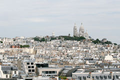 Monmartre hill. View of the Monmartre hill in Paris with Basilique Sacre-Coeur and roof of other houses royalty free stock photo