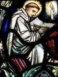 Monnik in gebrandschilderd glas Stock Fotografie