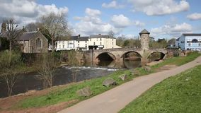 Monnow Bridge Monmouth Wales uk medieval fortified river bridge and tourist attraction pan stock video footage