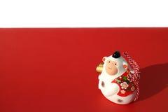 Mono blanco del Año Nuevo en el rojo y blanco Imagenes de archivo