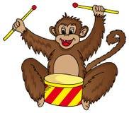 Mono con el tambor Foto de archivo