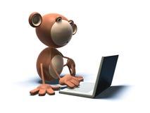 Mono con una computadora portátil Fotografía de archivo