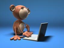 Mono con una computadora portátil Imagenes de archivo