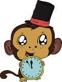 Mono de la Navidad con el reloj Fotografía de archivo