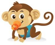 Mono del bebé con el pacificador Imagen de archivo libre de regalías
