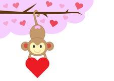 Mono en amor con el corazón rojo Foto de archivo