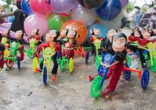 Mono en un juguete del niño de la bici Imagenes de archivo