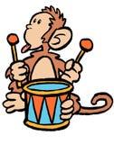 Mono en un tambor Imagenes de archivo
