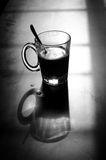 Mono Glass Cup Near Window Royalty Free Stock Images